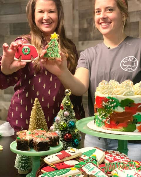 sami cone and courtney from baked on 8th in nashville with decorated christmas cookies