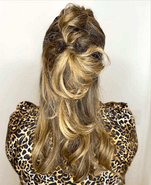 Back of Sami Cone's Hair whimsical partial updo by Stan Newton at Jon Alan Salon Capital View